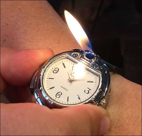 Wristwatch cigar lighter.